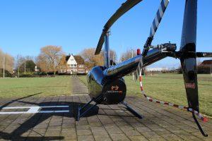 Helikopter Robinson R44 Raven II PH-JFC HeliCentre bij Manoir Restaurant Inter Scaldes