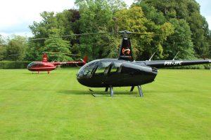 Helikopter Robinson R44 Raven II PH-JPS en PH-JFC HeliCentre